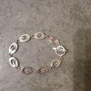 Silver Guess bracelet.